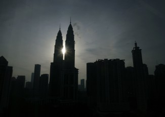 The sun rises behind the Petronas Twin Towers in Kuala Lumpur on 2 April 2009. (Photo: Reuters)