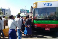 Passengers queue outside a newly rebranded Yangon Bus Service bus in Rangoon on Monday. (Photo: DVB)