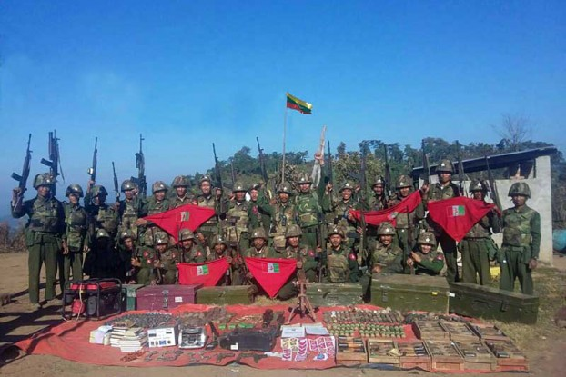 Burmese soldiers pose for a victory photo after seizing a Kachin rebel base in Mansi on 18 January 2017. (PHOTO: Office of the Commander-in-Chief)