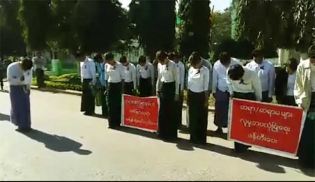 Schoolteachers in Hpakant pay respect on 22 January 2017 to the memory of their colleague, Kyaw Zin Htun, who was shot dead the week before. (PHOTO DVB)