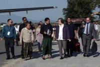 UN human rights rapporteur Yanghee Lee is met at Myitkyina Airport on 10 January 2017 by local government officials. (PHOTO DVB)
