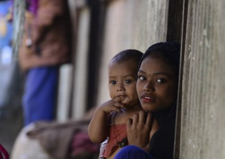 Rohingya refugees look on in a refugee camp in Teknaf, in Bangladesh's Cox's Bazar district, on 26 November 2016. (Photo: AFP)