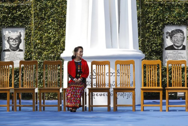 State Counsellor Aung San Suu Kyi sits in front of the Panglong monument ahead of a peace dialogue with ethnic representatives to mark the 70th anniversary of Union Day in Panglong, Shan State, on 12 February 2017. (Photo: AFP)