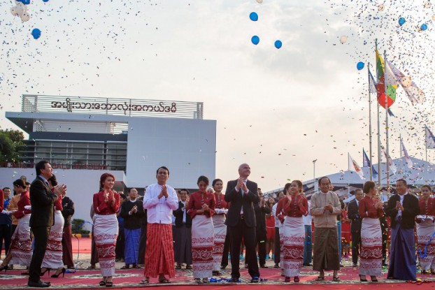 Myanmar Football Federation President Zaw Zaw, left, Rangoon Chief Minister Phyo Min Thein, second left, and FIFA President Gianni Infantino, centre, take part in a ribbon-cutting ceremony to open a national football academy in Rangoon on 17 February 2017. (Photo: AFP)