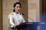 State Counselor Aung San Suu Kyi speaks during a memorial ceremony for murdered lawyer Ko Ni and taxi driver Ne Win in Rangoon on 26 February, 2017. (PHOTO: AFP)