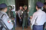 Burmese police officers and Tatmadaw soldiers search the NMSP office in Ye, southern Mon State, on 15 February 2017.