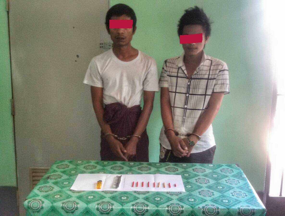 Two suspects in an illicit narcotics case allegedly involving a member of the Defence Services' Directorate of Military Affairs Security are pictured with the drugs they were caught in possession of. (Photo: Supplied)