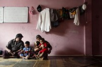 A Rohingya family living in Kuala Lumpur sits in the living room of their house in Kuala Lumpur on 31 May 2012. (Photo: Reuters)