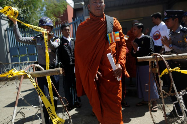 A Buddhist monk exits the Thai Embassy after delivering a statement during a protest in front of the embassy in Rangoon against the Thai military government invoking a special emergency law to let authorities search the Dhammakaya temple in an attempt to arrest a former abbot, on 24 February 2017.  (Photo: Reuters)