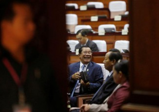 Cambodia's Prime Minister Hun Sen, centre, laughs at the National Assembly of Cambodia during a plenary session in central Phnom Penh on 20 February 2017. (Photo: Reuters)