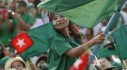 A supporter waves a flag during a Union Solidarity and Development Party (USDP) campaign rally in Rangoon on 6 November 2015. (Photo: Reuters)