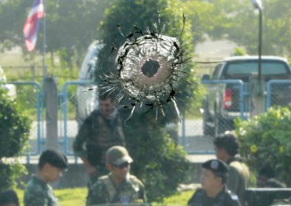 A bullet hole is pictured as military personnel inspect the site of multiple bomb and gun attacks by insurgents at Cho-airong district in the troubled southern Thai province of Narathiwat on 14 March 2016. (Photo: Reuters)
