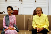State Counsellor Aung San Suu Kyi is greeted by the deputy prime minister of Thailand, Somkid Jatusripitak, right, at Suvarnabhumi Airport in Bangkok, on 23 June 2016. (Photo: Reuters)