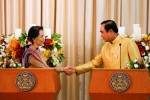 Burma's State Counsellor Aung San Suu Kyi, left, shakes hands with Thai Prime Minister Prayuth Chan-ocha during an MoU ceremony at Government House in Bangkok on 24 June 2016. (Photo: Reuters)