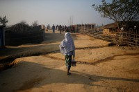 A Rohingya refugee walks with a tiffin carrier in the morning at the Kutupalang unregistered refugee camp in Cox's Bazar, Bangladesh, on 4 February 2017. (Photo: Reuters)