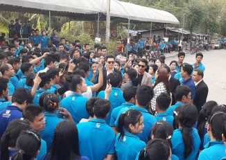 Blue-shirted factory workers present demands to bosses of the Intex motorbike helmet factory in Bangkok on 22 February 2017. (PHOTO: Ye Min)