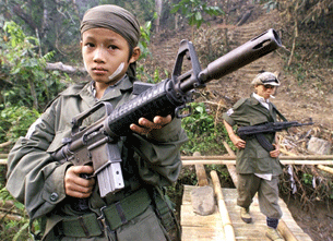 Child soldier at Thai-Burmese border. (PHOTO: AFP)