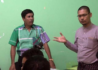 Oo Oo Nyein (left) is introduced at a press conference in Rangoon on 11 February 2017 by Myanmar Journalist Network general secretary Zeya Hlaing. (PHOTO: DVB)