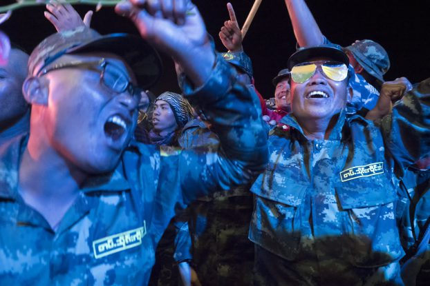 Soldiers rock it out during a closing performance by a local musical group.
