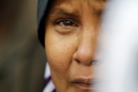 An ethnic Rohingya woman living in Malaysia, cries during a rally against sectarian violence in Burma (PHOTO: Reuters)
