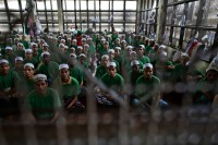 In this picture from July 2013, Rohingya Muslims are shown inside an immigration detention centre in Thailand's Kanchanaburi province. (Reuters)