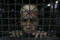 In this file picture, a Rohingya migrant looks out from an Immigration Detention Centre in Thailand. (PHOTO: Reuters)
