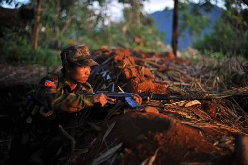 In this file photo, a soldier is dug into a frontline hilltop in Kachin state, northern Burma (PHOTO: AFP)