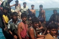 Rohingya refugees sit in a boat as they are intercepted by Thai authorities off the sea in Phuket, southern Thailand. (PHOTO: AP)