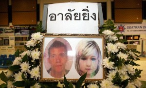 Passport photos of David William Miller and Hannah Victoria Witheridge were placed on a memorial on Koh Tao. (PHOTO: Supapong Chaolan/ Bangkok Post)