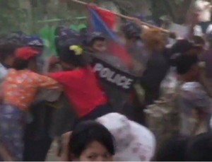 The moment police and striking workers clashed on Friday was captured by a retreating cameraman. (PHOTO: DVB)