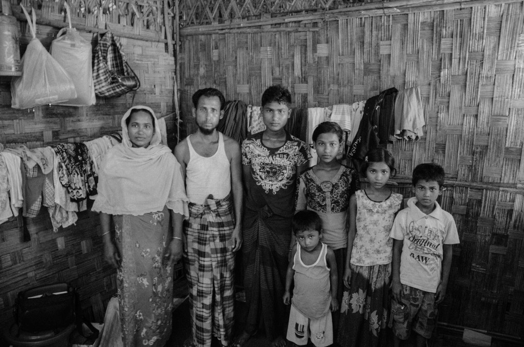 Ismail's parents, Khoilla Mia and Bodu Jamal, pose with five of their children at Thet Kae Pyin IDP camp, near Sittwe, Burma (Photo: Alex Bookbinder)