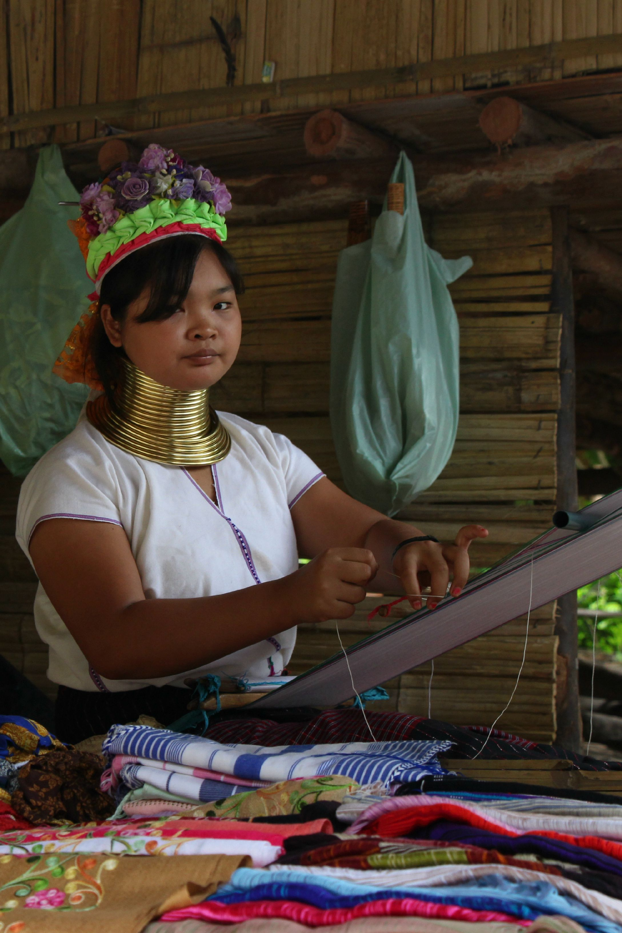 The women weave everything they sell on traditional wooden looms, enforcing their 'tribal' image. (PHOTO: Melanie Keyte).
