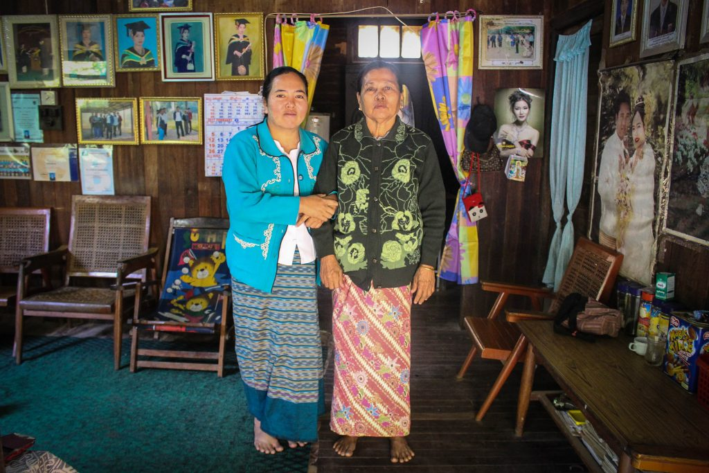 Ma Zar Chi Oo with her mother in their home. Her mother worked in the textiles industry for 50 years. Ma Zar Chi took over the factory job at age 18. (Photo: Libby Hogan / DVB)